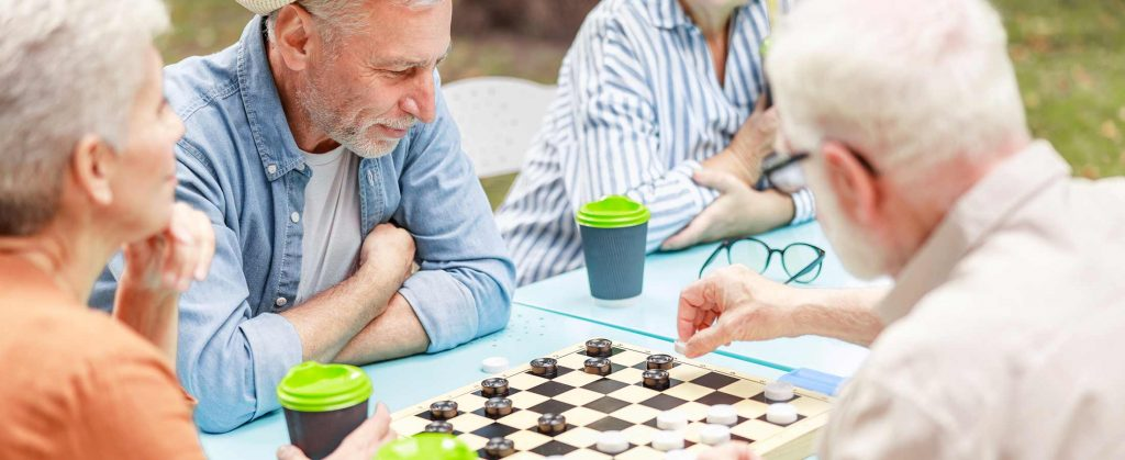 senior citizens playing checkers